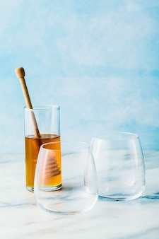 Empty glasses and honey on a table