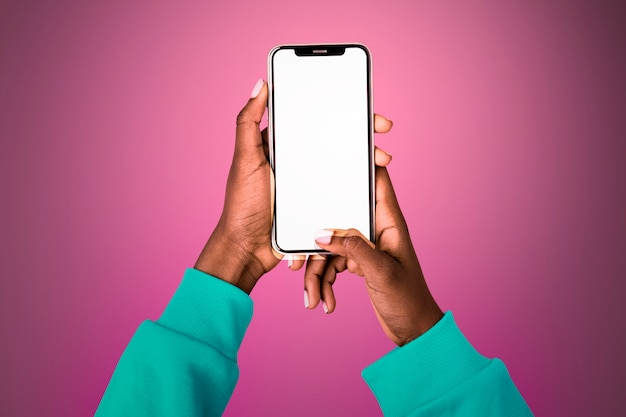 Empty glowing screen with person holding mobile phone
