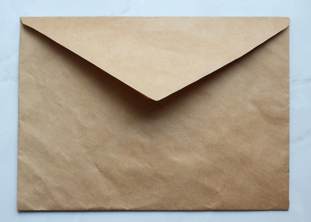 An empty golden envelope on the table
