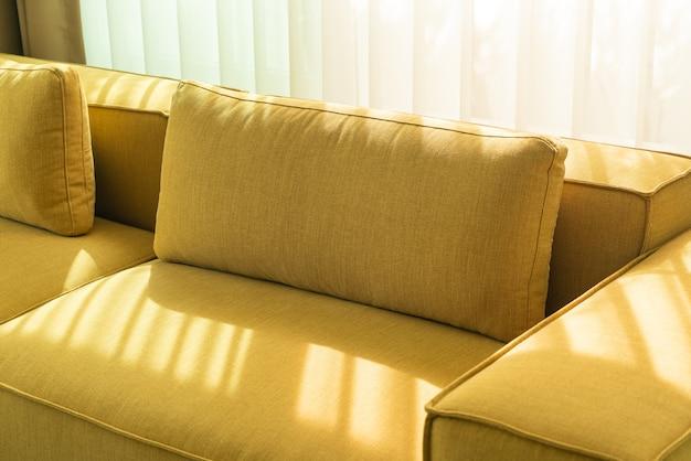 Empty golden mustard sofa in living room