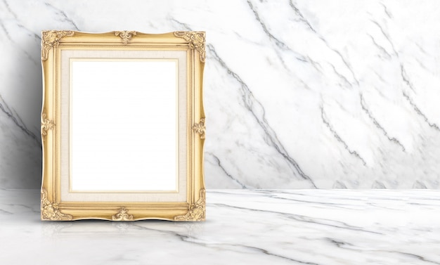 Empty golden vintage frame at white clean marble wall and floor background