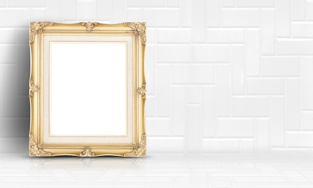 Empty golden vintage frame at white clean tile wall and floor background
