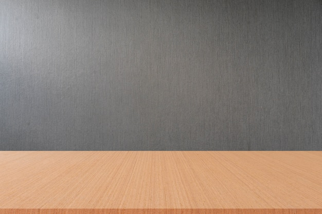Empty gray color wallpaper with sepia wood floor