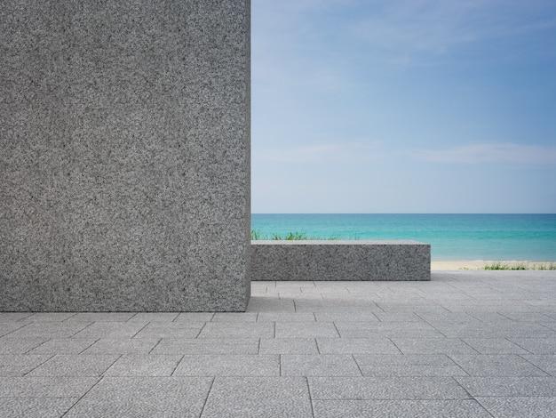 モダンなビーチハウスの庭の近くの屋外テラスの空の灰色の小石の壁