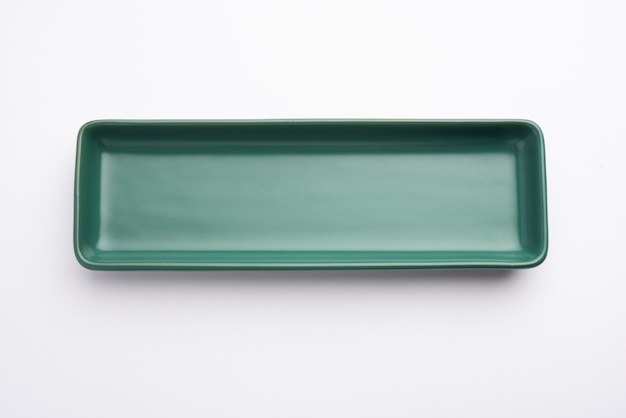 Empty green ceramic rectangular plate isolated on white surface
