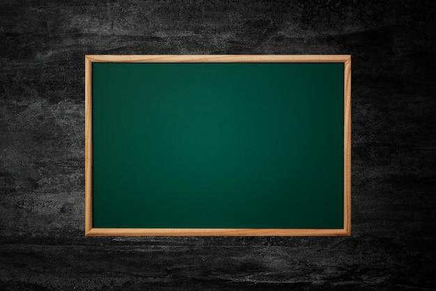 Empty green chalkboard or school board background on wall