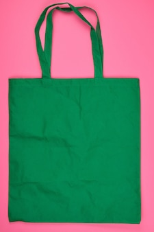 Empty green ecological bag made of viscose with long handles