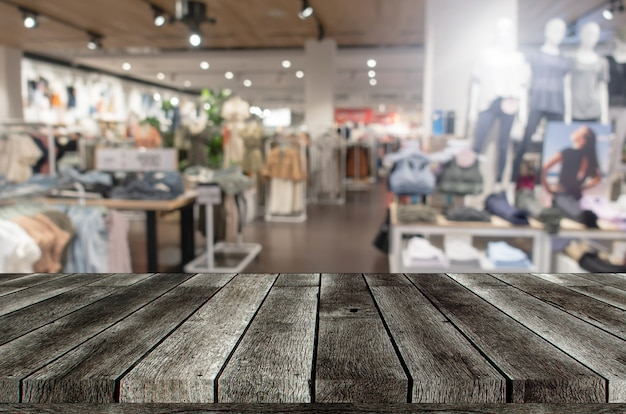 Empty grey wooden table or wooden terrace with blurred image
