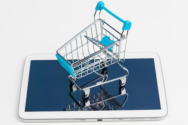 Empty grocery toy  shopping cart on a table