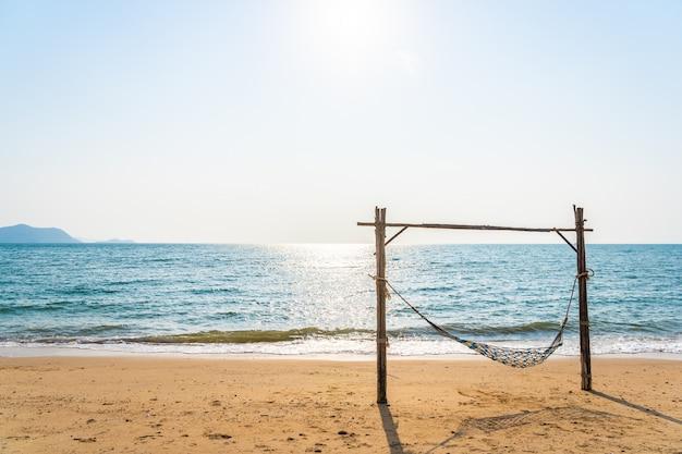 Empty hammock swing on the beautiful beach and sea