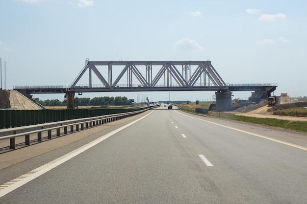 Empty highway with bridge under construction
