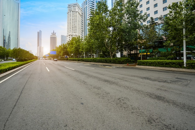 Empty highway with cityscape and skyline of qingdao,china.