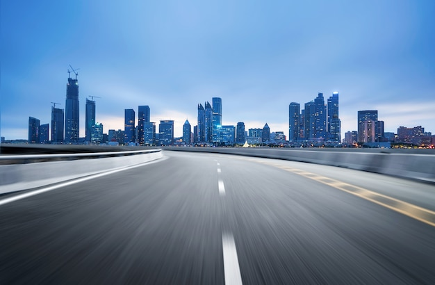 Empty highway with cityscape and skyline of qingdao, china.
