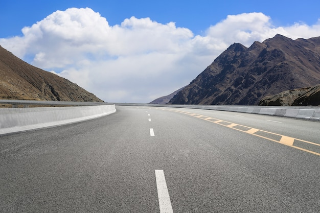 Empty highways and distant mountains