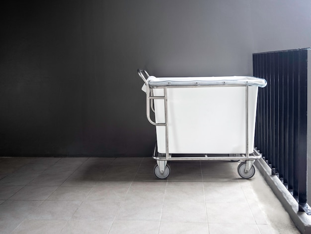 Empty hotel housekeeping maid laundry trolley