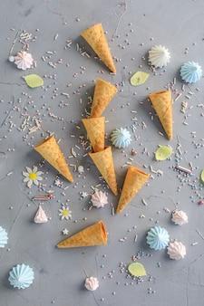 Empty ice cream cones gray background. top view.