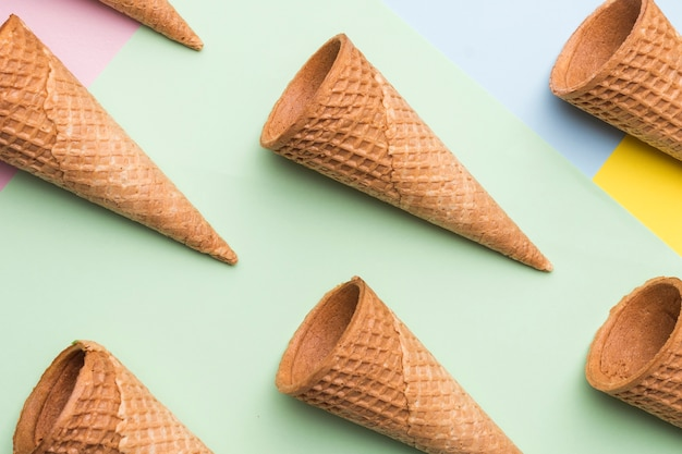 Empty ice cream waffle cones on colourful background