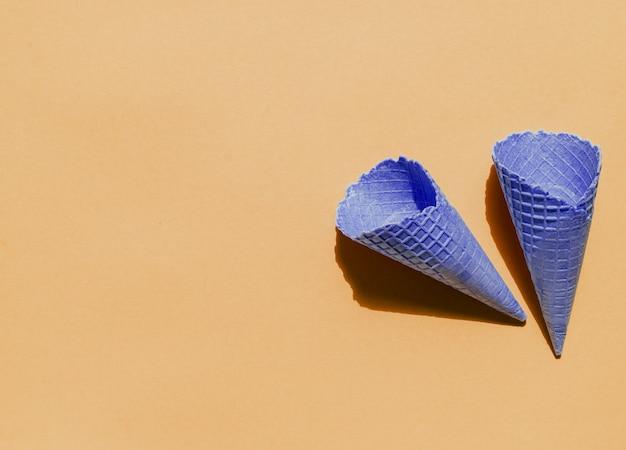 Empty ice cream waffle cones on light background