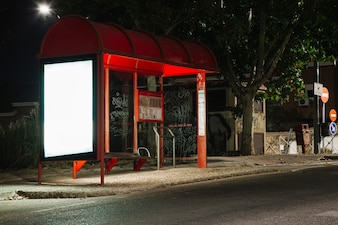 Empty illuminated billboard at bus stop station