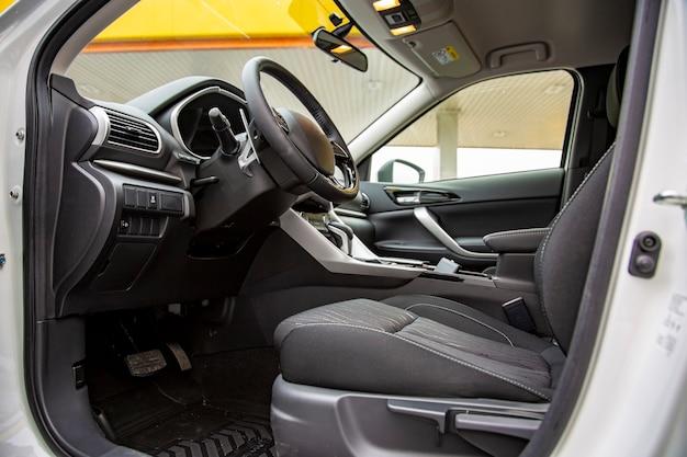 Empty interior of modern premium car. black interior, driver's seat. no people