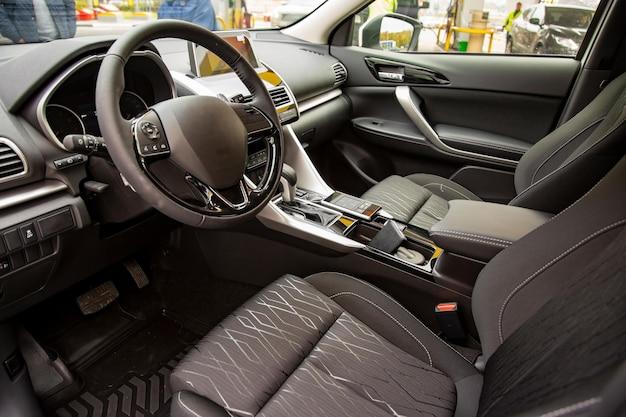 Empty interior of modern premium car black interior drivers seat