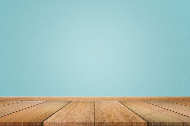Empty interior room background with light blue cement wall and brown wooden floor