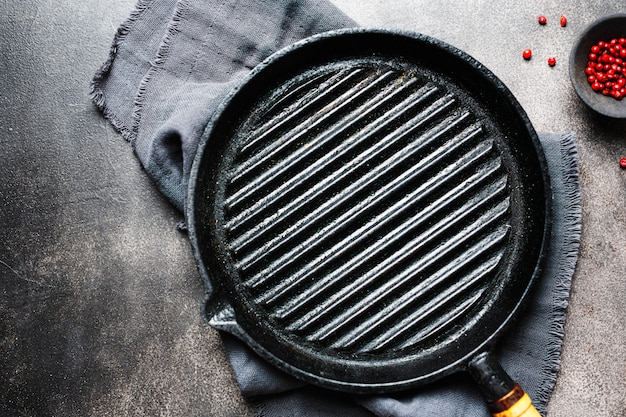 Empty iron grill pan on table