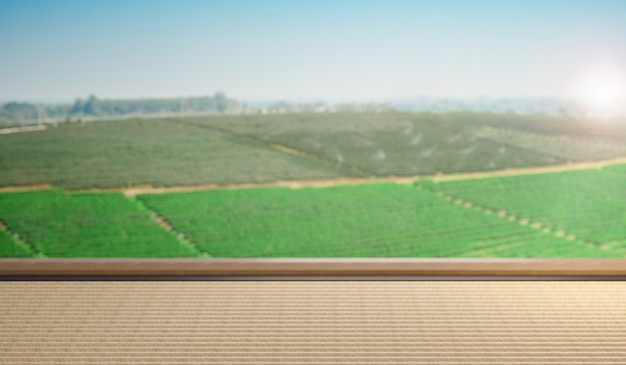 フィールドランドスケープの背景を持つ前景のテーブルトップに焦点を当てた、プロダクトプレースメントまたはモンタージュ用の空の日本のマットテーブル。 3dイラストレーションレンダリング。
