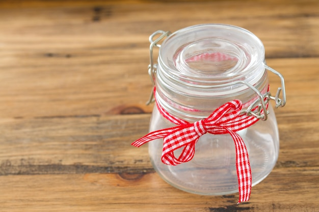 Empty jar on brown surface