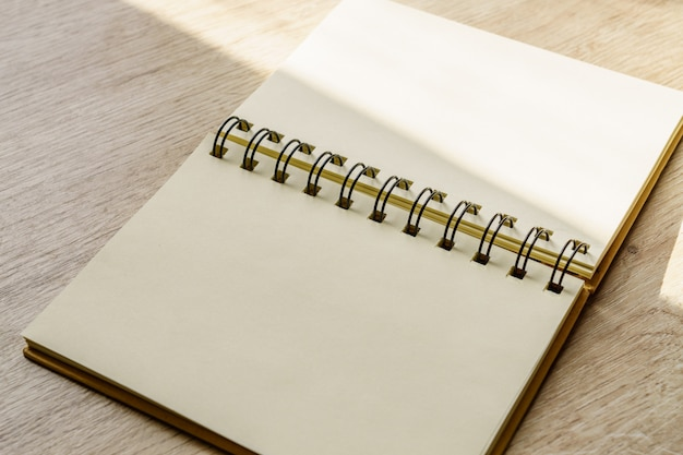 Empty kraft notebook on table background