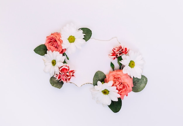 Empty label decorated with flowers and leaves on white backdrop