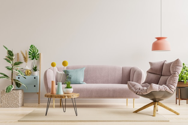 On an empty light white wall background there is a living room with a sofa and an armchair