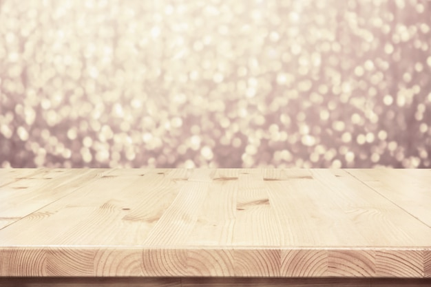 Empty light wooden table top, counter with blurred bokeh lights party backdrop