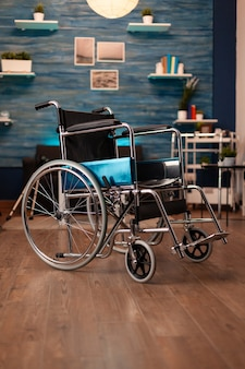 Empty living room in apartment with wheelchair on floor
