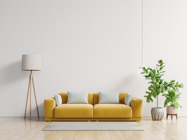 Empty living room with yellow sofa, plants and table on empty white wall background.