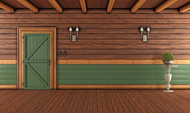 Empty living room of a wooden house with closed door