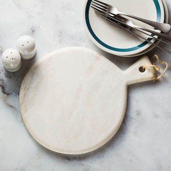 Empty marble cutting board on a table