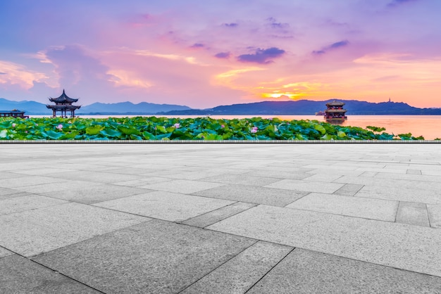 The empty marble floor with beautiful scenery and sky clouds.