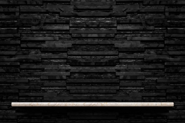 Empty marble stone shelf at black layer marble tile wall background