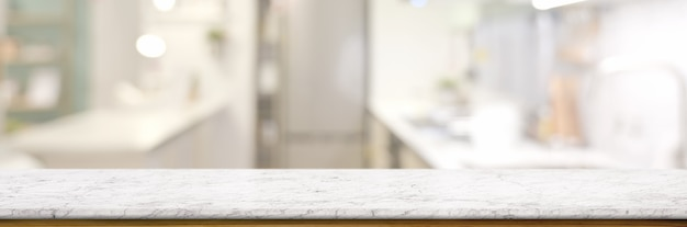 Empty marble table in blurred kitchen room