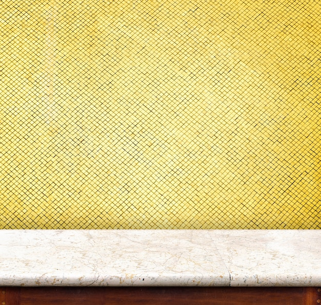 Empty marble table top at golden mosaic tiles wall,template mock up for display of your product