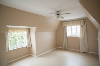 Empty master bedroom in cream and beige in a new house