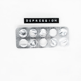 Empty medicine blister with depression label isolated over white background