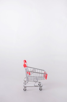 An empty metal cart on a white isolated background with space for text.