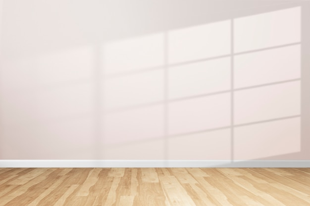 Empty minimal room with window shadow on a pink wall