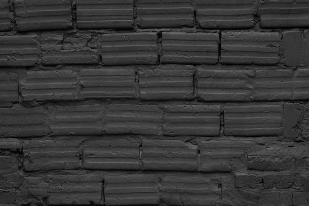 空のモダンな黒レンガの壁のテクスチャ