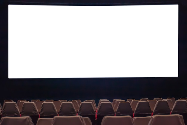 Empty movie screen with blurry of chair in the movie theater.