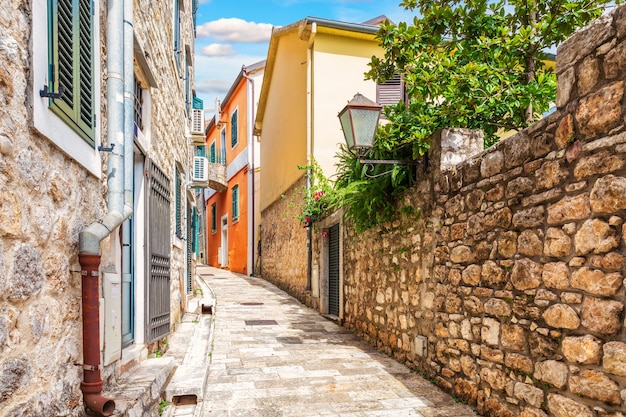 Empty narrow medieval european street in the old town of herceg novi, montenegro.