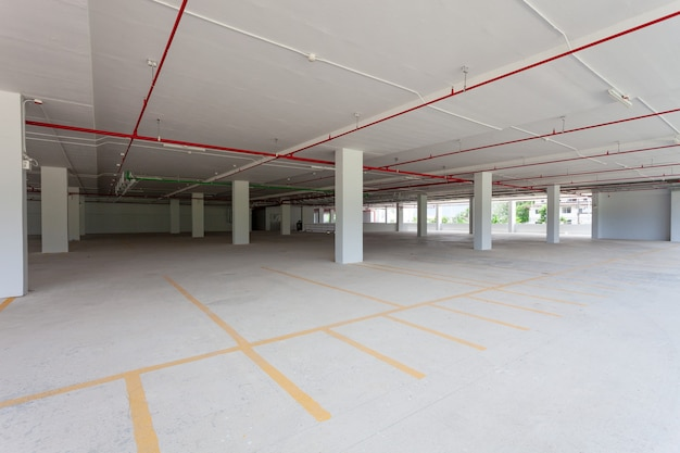 Empty new parking garage underground interior in apartment or business building office and supermarket store.