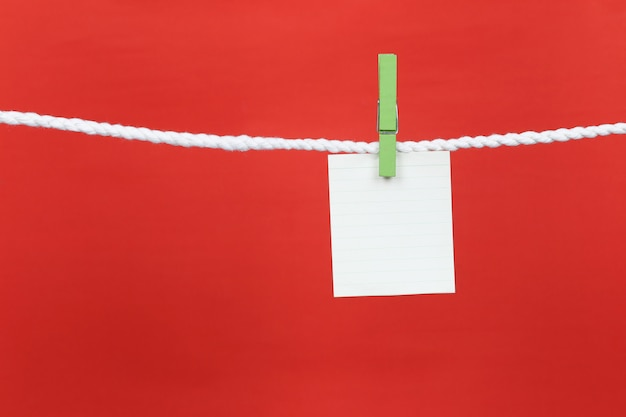 Empty note paper hang on the clothesline.